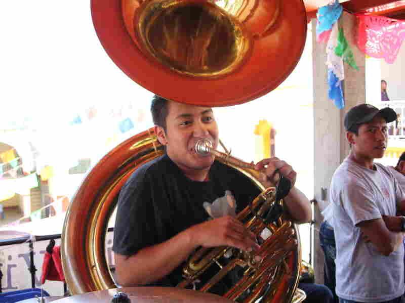Julian Gonzalez playing his tuba in Santa Maria Tavehua.