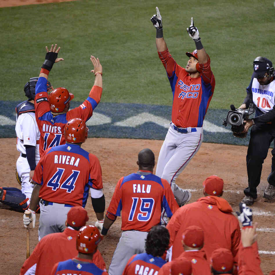 Puerto Rico's Alex Rios celebrated Sunday with teammates after hitting a two-run home run in the seventh inning against Japan in the semi-finals of the World Baseball Classic at AT&T Park in San Francisco.