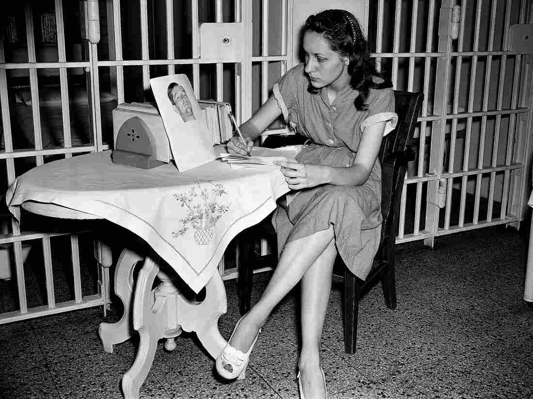 Ruth Ann Steinhagen, then-19, in the Cook County Jail after she shot Philadelphia Phillies first baseman Eddie Waitkus in 1949. On the table: a photo of Waitkus taken in the hospital where he was recovering from his bullet wound. The story of his shooting was the inspiration for Bernard Malamud's novel The Natural. Steinhagen died this past December.