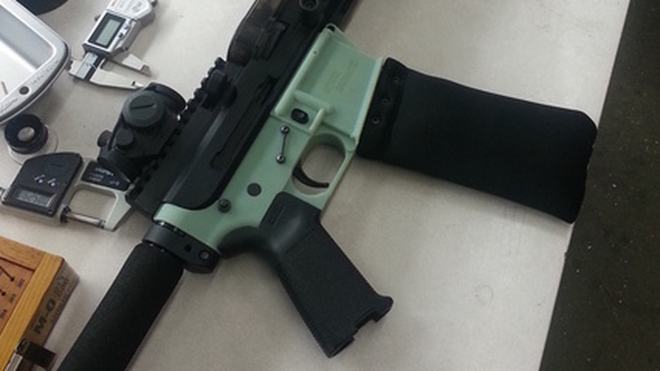 This AR-15 rifle's lower receiver (in soft green color) was produced with a 3-D printer. The 3-D printing industry has criticized the use of the technology for gun part making. (Courtesy of Defense Distributed Dev Blog)