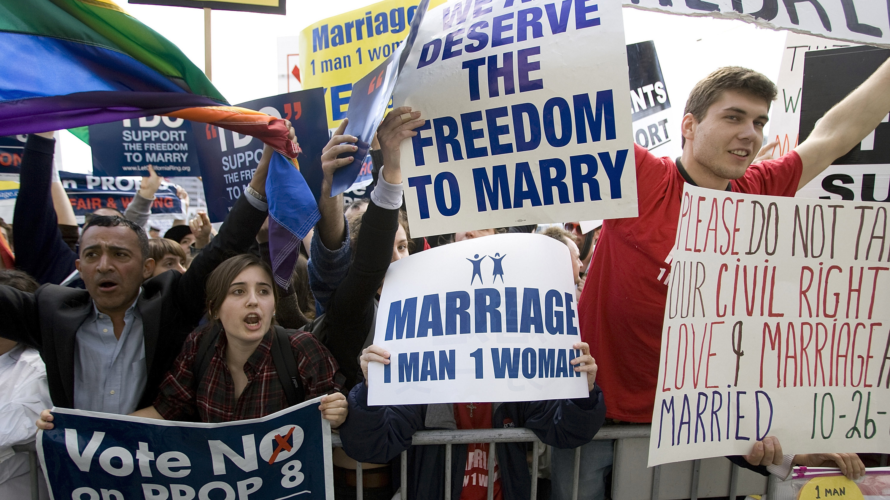 People rally in front of the California Supreme Court building in March 2009 after arguments were heard on the gay marriage ban.