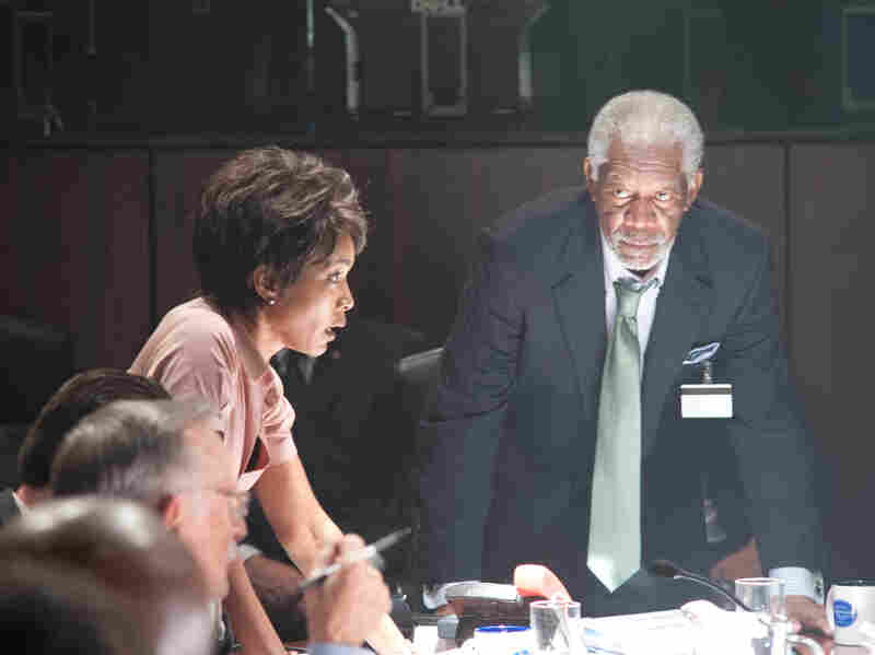 Angela Bassett portrays Secret Service Director Lynn Jacobs and Morgan Freeman is acting President/Speaker of the House Allan Trumbull in Olympus Has Fallen.