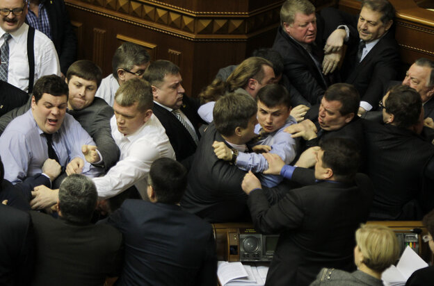 Ukrainian opposition and majority lawmakers fight around the rostrum during the session of parliament in Kiev, Ukraine, on Tuesday.
