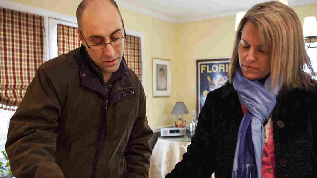 Patrick Bove, a homebuyer (and seller), and Redfin real estate agent Lynn Ikle look at a pamphlet at an open house in Towson, Md.