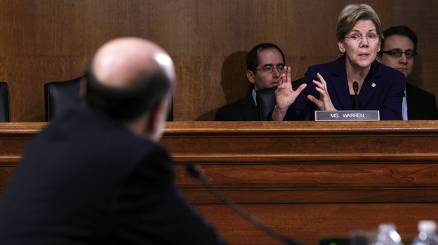 Sen. Elizabeth Warren, D-Mass., questions Federal Reserve Board Chairman Ben Bernanke during a Senate hearing last month. Senators from both ends of the political spectrum argue that financial reforms are insufficient to protect taxpayers from potential risks posed by large banks. (Reuters/Landov)