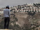 A Jewish settler looks at the West Bank settlement of Maaleh Adumim from the E-1 area on the eastern outskirts of Jerusalem on Dec. 5. The Israelis are planning a controversial housing project in E-1.