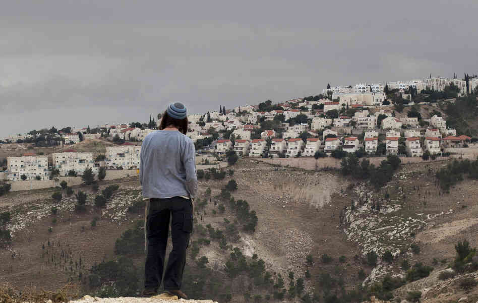 A Jewish settler looks at the West Bank settlement of Maaleh Adumim from the E-1 area on the eastern outskirts of Jerusalem on Dec. 5. The Israelis are planning a controversi