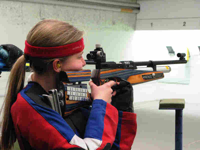 Greta Wolff, an 11-year-old immigrant from Germany, shoots during target practice at the gun club.