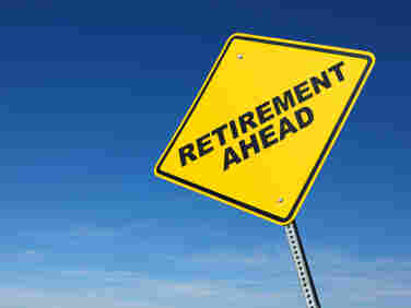 "A yellow sign reads ""Retirement Ahead."""