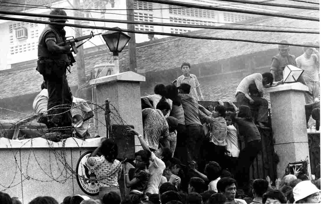 Crowds of people attempted to scale the wall of the U.S. Embassy in Saigon, Vietnam, on April 29, 1975, trying to get to the helicopter pickup zone just before the end of the Vietnam War.