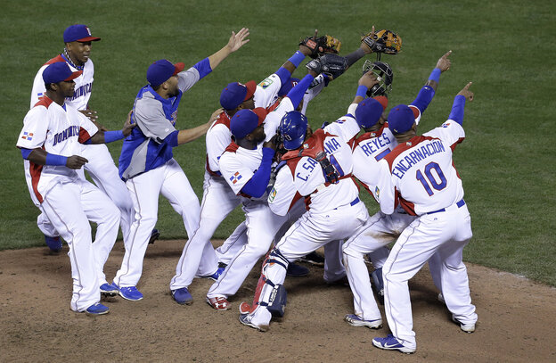 The Dominican Republic celebrates after beating the Netherlands 4-1 in Monday's semifinal game of the World Baseball Classic in San Francisco.
