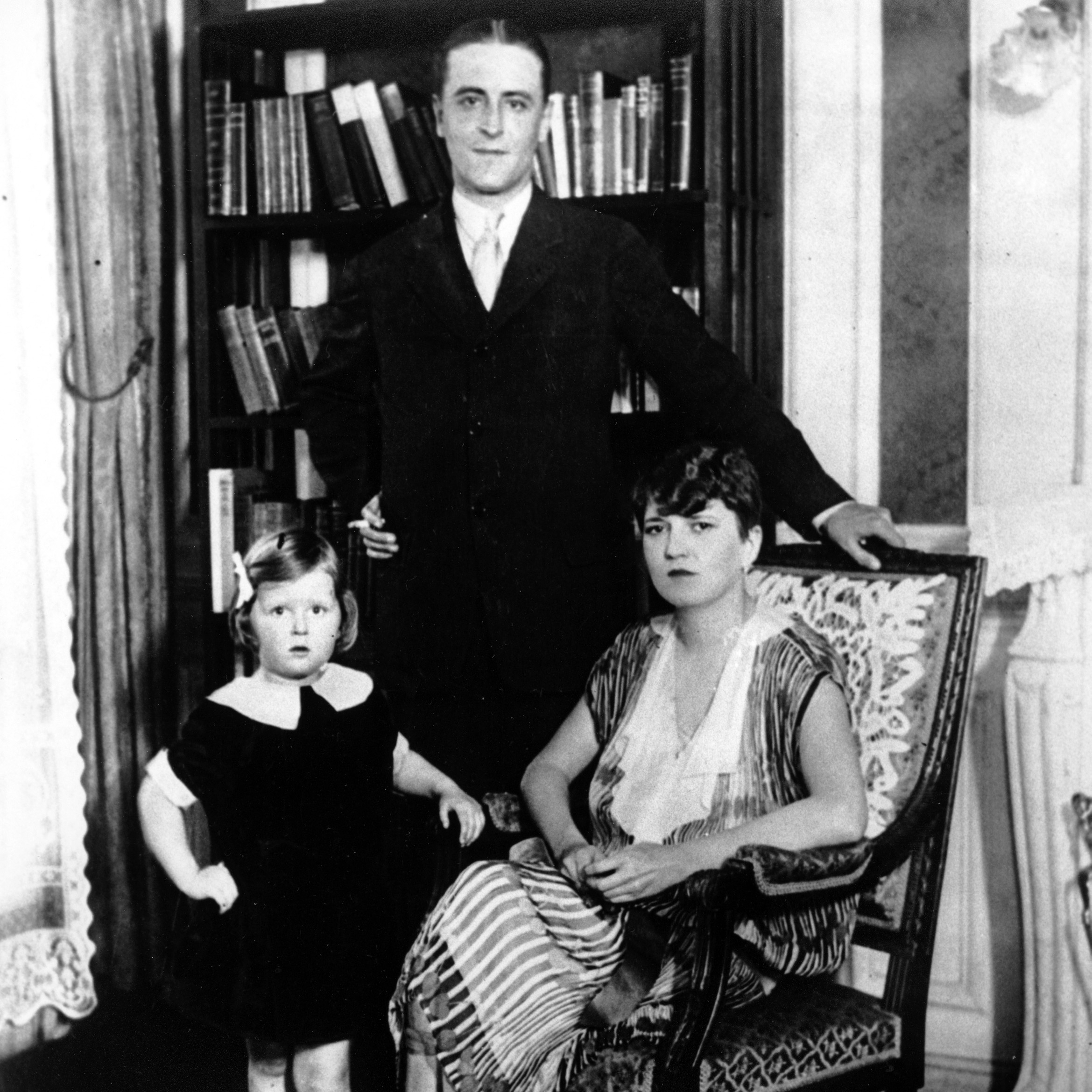 "Zelda and F. Scott Fitzgerald pose with their daughter, Frances, aka ""Scottie,"" in the family's Paris apartment in 1925."