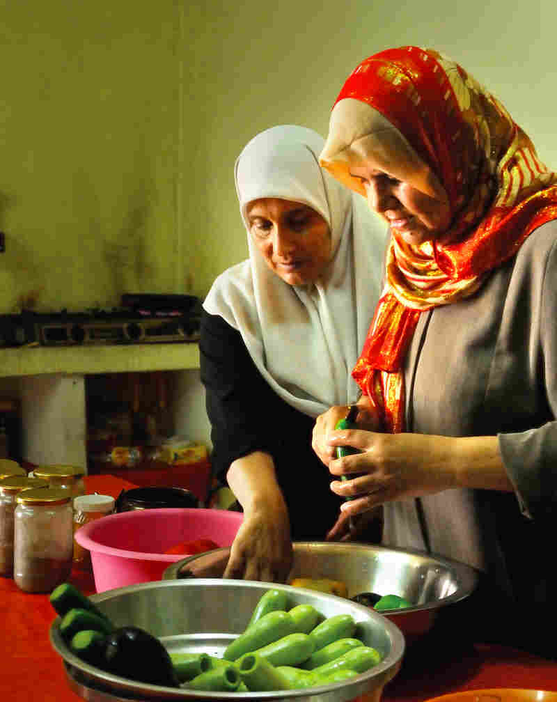 "Members of the Zeitun Women's Cooperative prepare a meal. These women take catering orders for special events, using the proceeds to help support their families in an area with ""nearly universal male under- and unemployment,"" the authors of The Gaza Kitchen write."