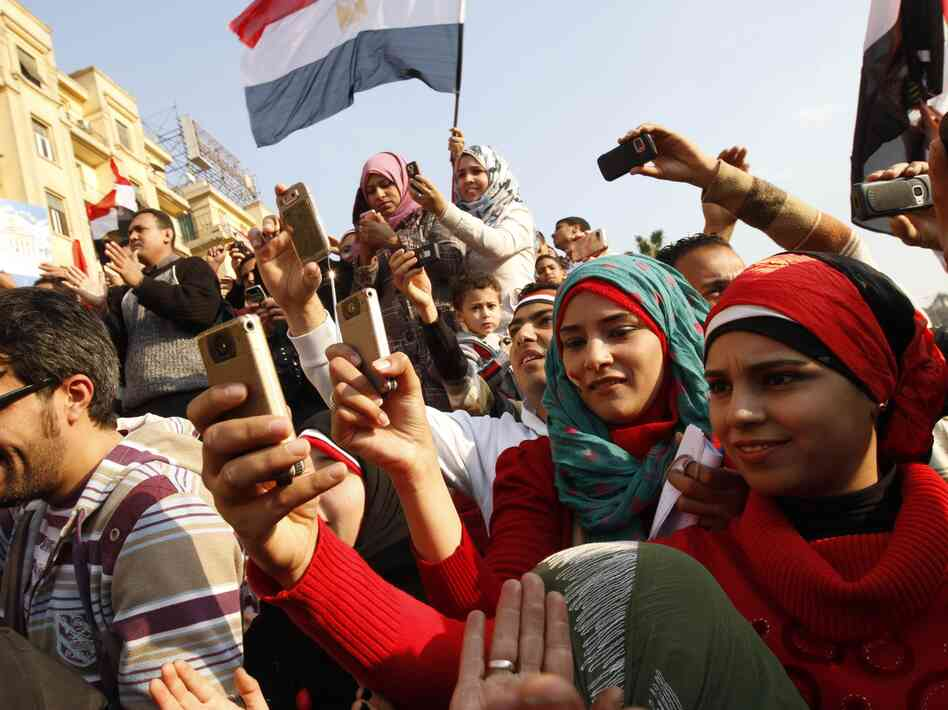 Egyptians use their mobile phones to record celebrations in Cairo's Tahrir Square, the epicenter of the popular revolt that drove Hosni Mubarak from power in 2011. Twitter was often used to record happenings during the Arab Spring.