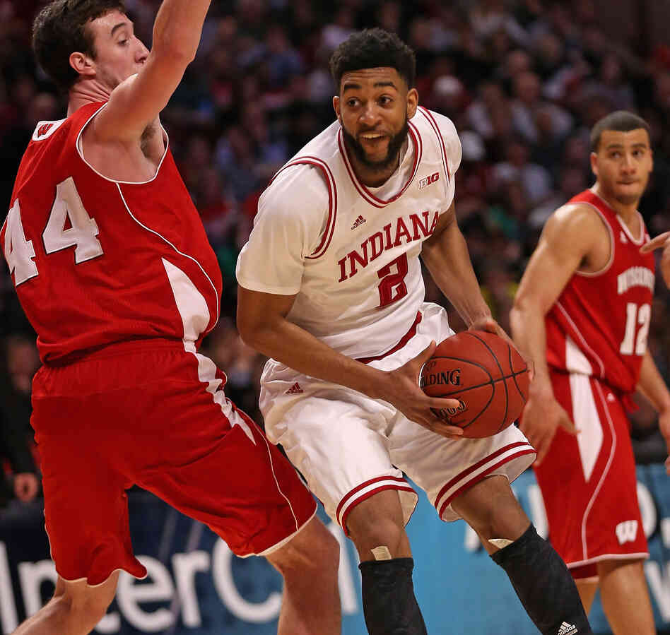 Christian Watford of the Indiana Hoosiers moves against Frank Kaminsky of the Wisconsin Badgers during a semifinal gam