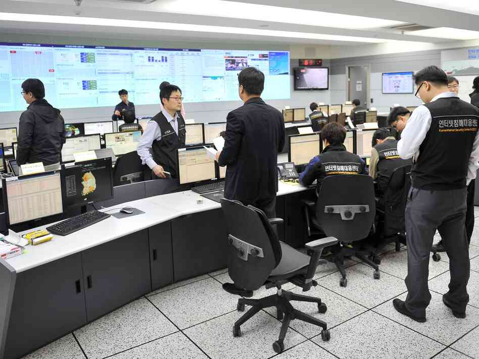 Members of the Korea Internet Security Agency check on cyberattacks at a br