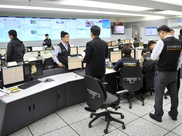 Members of the Korea Internet Security Agency check on cyberattacks at a briefing room Wednesday.
