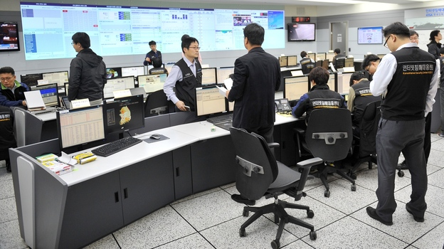 Members of the Korea Internet Security Agency check on cyberattacks at a briefing room Wednesday. (AFP/Getty Images)