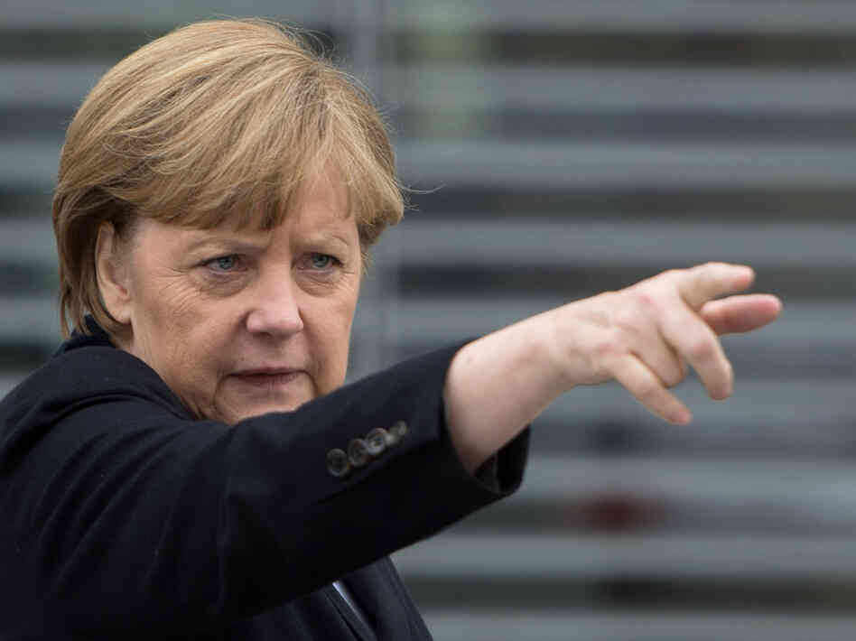 German Chancellor Angela Merkel gestures as she leaves a parliamentary session on