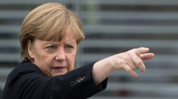 German Chancellor Angela Merkel gestures as she leaves a parliamentary session on Wednesday in Berlin. (AFP/Getty Images)