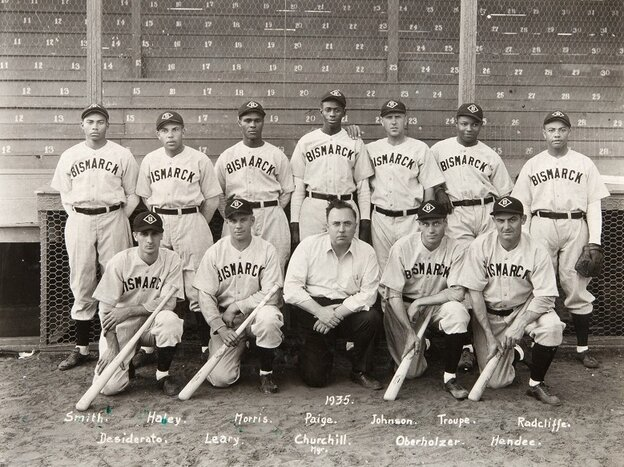 The only known photograph of the 1935 Bismarck town team shows manager Neil Churchill, kneeling in the center, and pitcher Satchel Paige standing behind him.