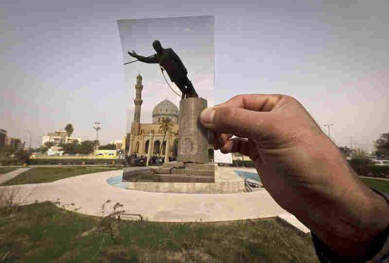 Ten years ago on live television, U.S. Marines memorably hauled down a Soviet-style statue of Saddam Hussein in Firdous Square — photographed in 2003 by Jerome Delay of AP. Today, that pedestal in central Baghdad stands empty. Bent iron beams sprout from the top, and posters of anti-American Shiite cleric Muqtada al-Sadr in military fatigues are pasted on the sides.