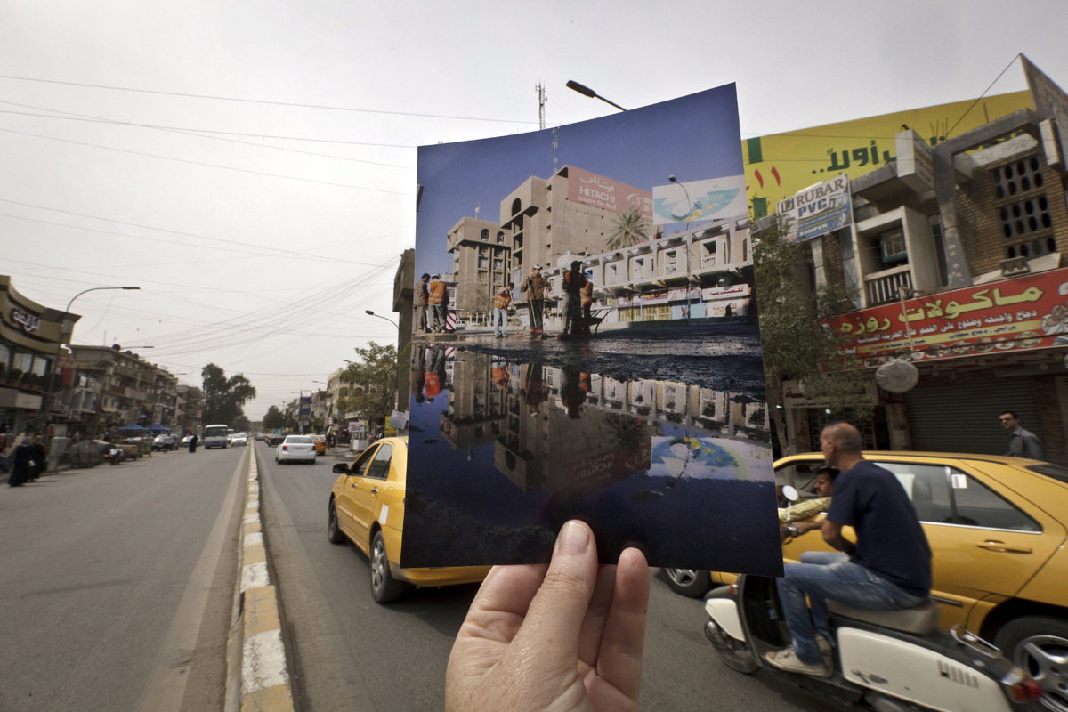 Today, motorists fill the main street in Baghdad's busy Karrada shopping district. The 2008 image was taken by Hadi Mizban after a bombing that killed 53 people and wounded 130.
