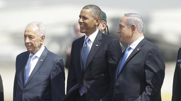 President Barack Obama is greeted by Israeli President Shimon Peres, left, and Israeli Prime Minister Benjamin Netanyahu upon his arrival ceremony at Ben Gurion International Airport in Tel Aviv, Israel, on Wednesday. (AP)