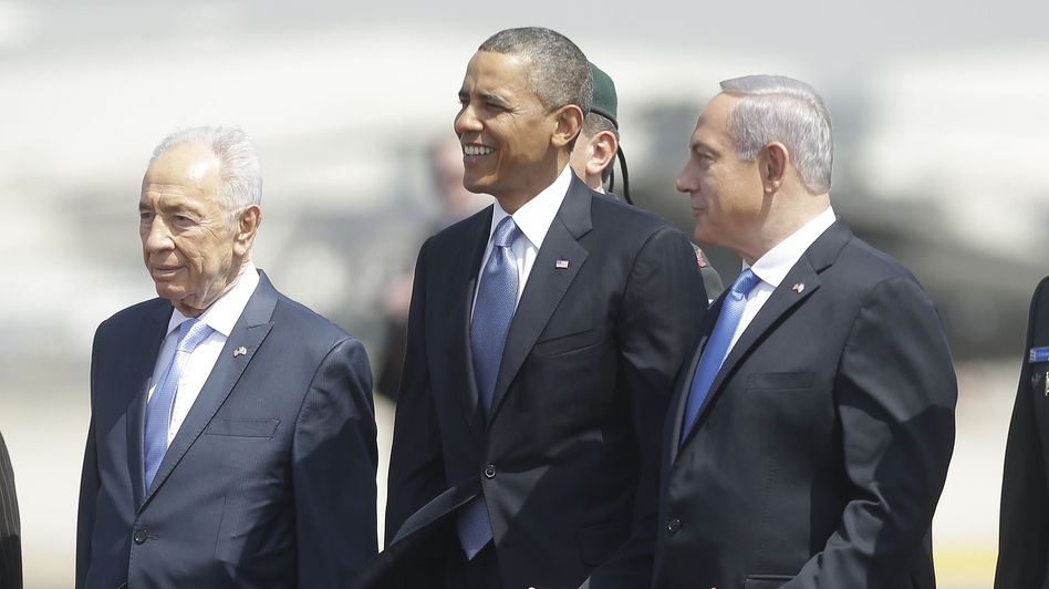 President Barack Obama is greeted by Israeli President Shimon Peres, left, and Israeli Prime Minister Benjamin Netanyahu upon his arrival ceremony at Ben Gurion International Airport in Tel Aviv, Israel, on Wednesday. (AP)