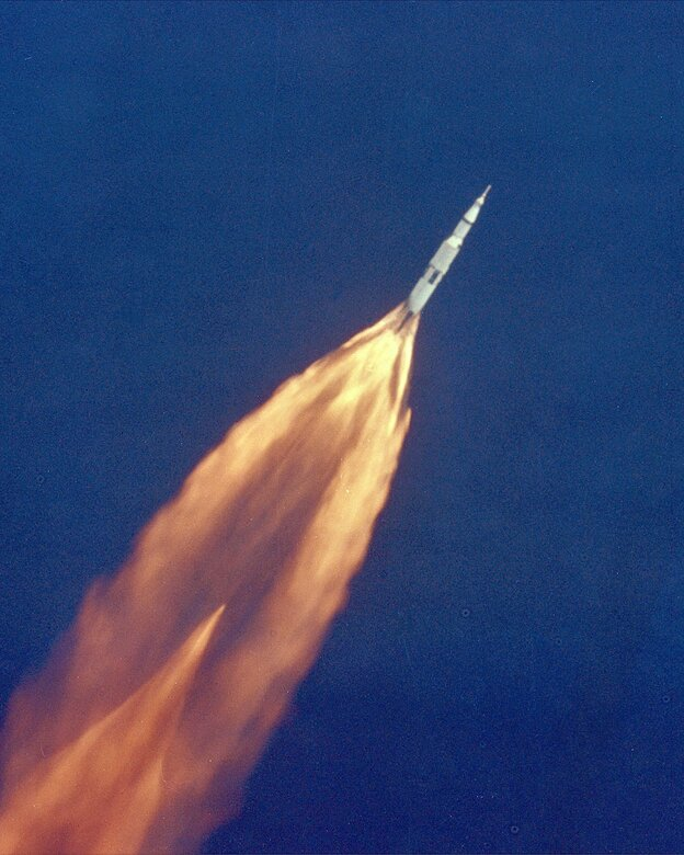 Apollo 11 climbs toward orbit after liftoff on July 16, 1969. In 2 1/2 minutes of powered flight, the S-IC booster lifts the vehicle to an altitude of about 39 miles, some 55 miles downrange.