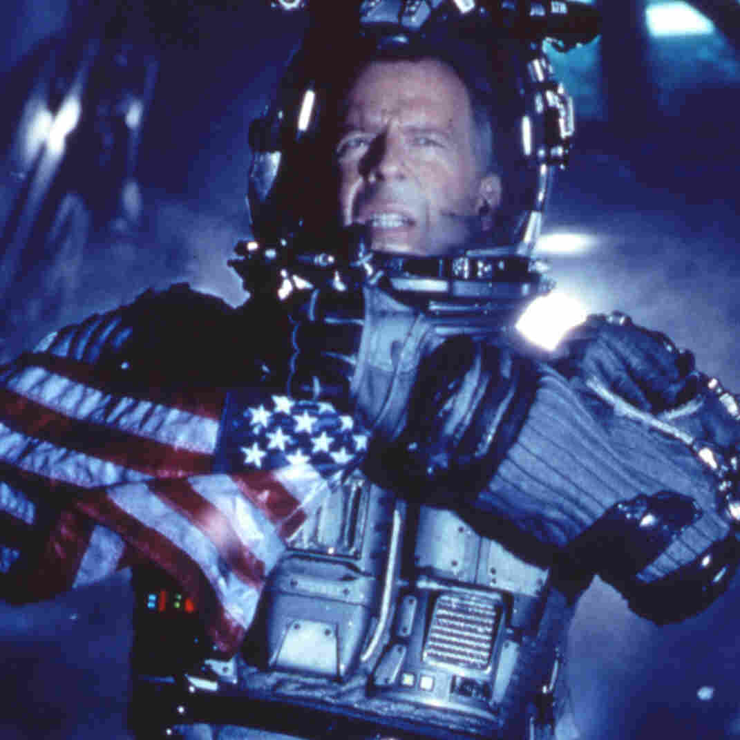 Actor Bruce Willis on the surface of an asteroid from the movie Armageddon. Lawmakers are questioning the likelihood of the movie's plot becoming reality.