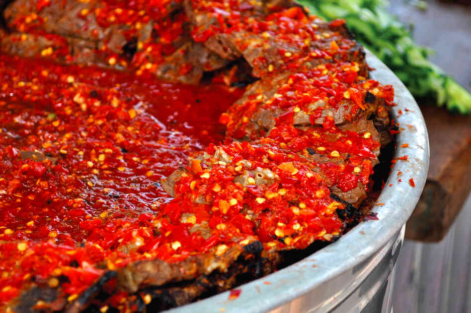 Filfil Mat'houn is a paste made of red chili peppers conserved in oil and sold as a condiment.