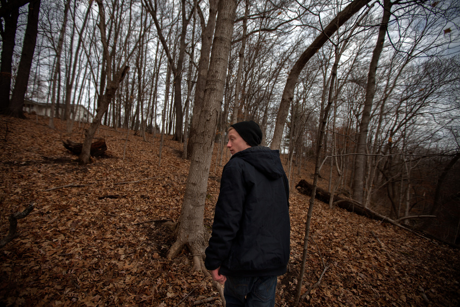 Piper walks in the woods behind his parents' home in Mount Carroll, Ill. He and Pacas were friends, and used to float on inner tubes in the nearby river. (NPR)