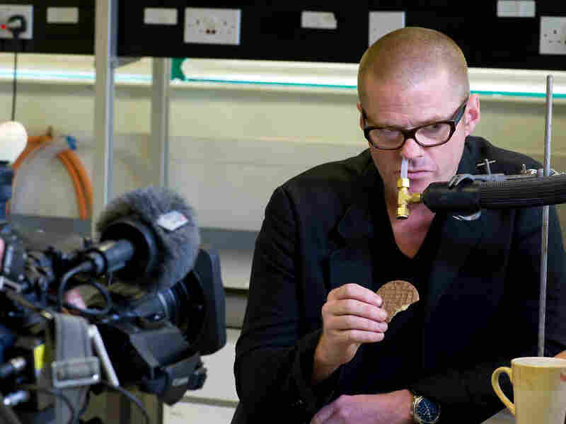 Hooked up to a gadget that measures food flavors, chef Heston Blumenthal tests whether a cookie tastes better after it's dipped into tea.
