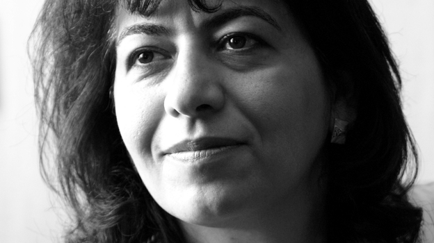 Dunya Mikhail is an Iraqi-American poet who teaches in Michigan. She has published five books in Arabic and two in English. (Courtesy of Dunya Mikhail)