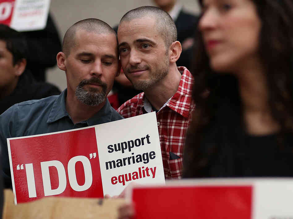 Frank Capley (left) and Joe Alfano protest the San Francisco county clerk's denial of marriage licenses to s
