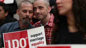 Frank Capley (left) and Joe Alfano protest the San Francisco county clerk's denial of marriage licenses to same-sex couples on Feb. 14.