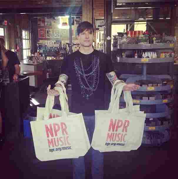 "Jessica Schreibstein from NPR snapped this fun photo of our own Emerson Brown, who was busy speading the good word about NPR Music. ""@emersonebrown is the Vanna White of @npr tote bags,"" she shared on Instagram."