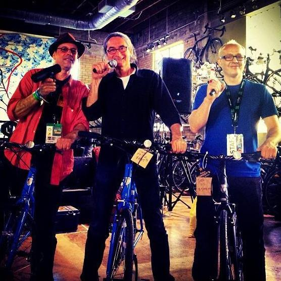 @tinydesk Bikes with mics. Bob Boilen, KEXP's Kevin Cole and Robin Hilton at Mellow Johnny's Bike Shop and a live Broadcast #sxsw