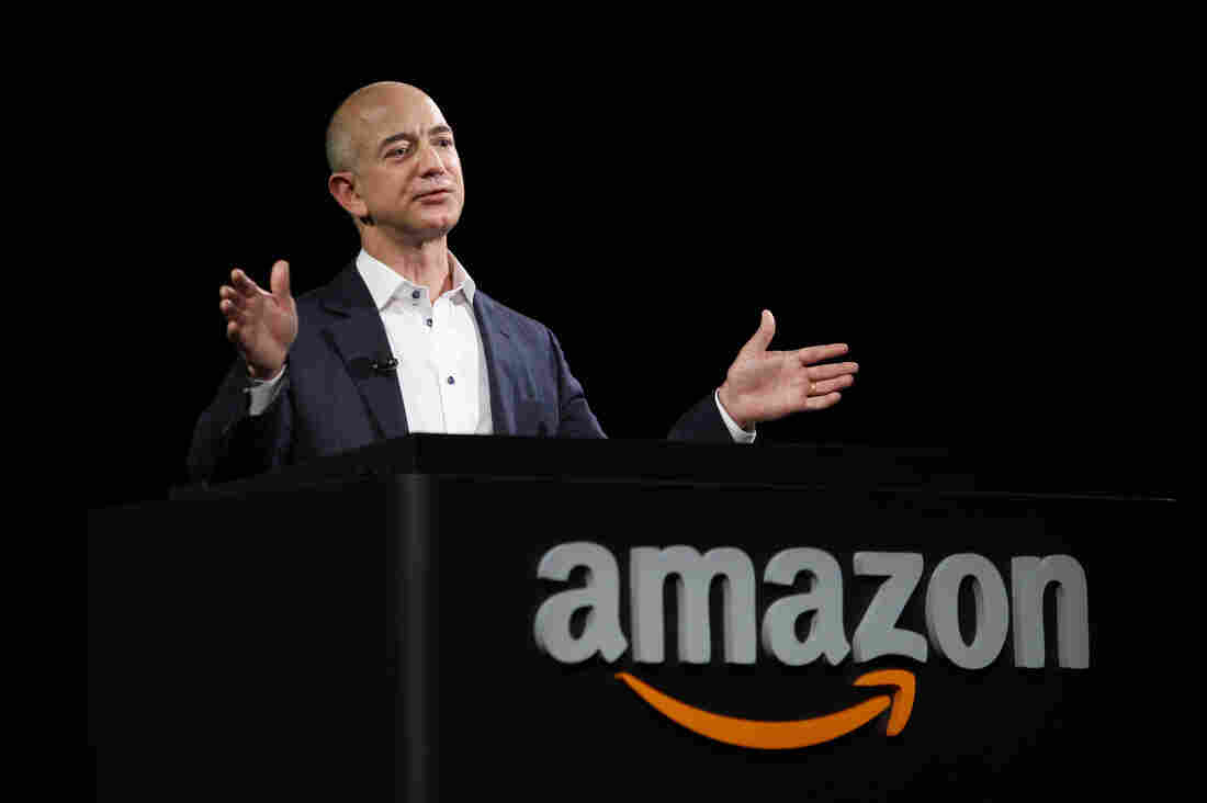 Amazon CEO Jeff Bezos unveils new Kindle reading devices at a press conference in 2012.