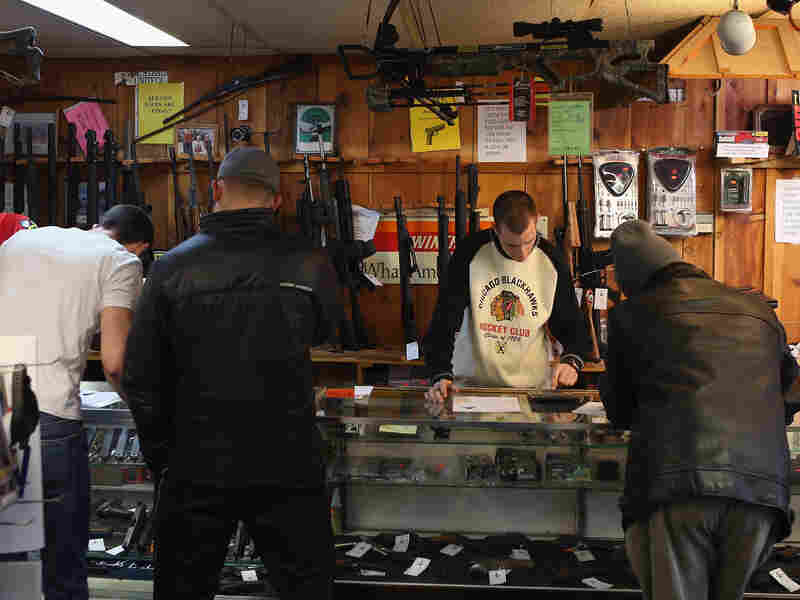 Customers shop for guns at Freddie Bear Sports sporting goods store in Tinley Park, Ill., in January. One of the gun provisions in the spending bill prevents the Justice Department from requiring gun dealers to conduct an inventory to see if guns are lost or stolen.