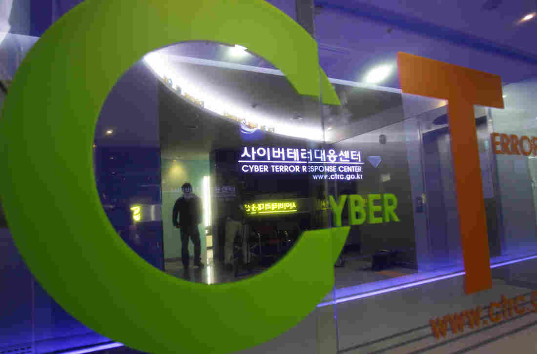 A man walks past the Cyber Terror Response Center at National Police Agency in Seoul, South Korea.