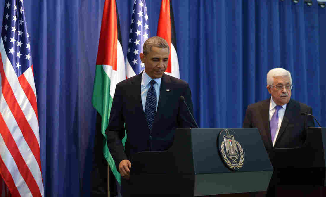 President Barack Obama arives for a joint press conference with Palestinian president Mahmoud Abbas at the Muqataa, the Palestinian Authority headquarters, in the West Bank city of Ramallah.