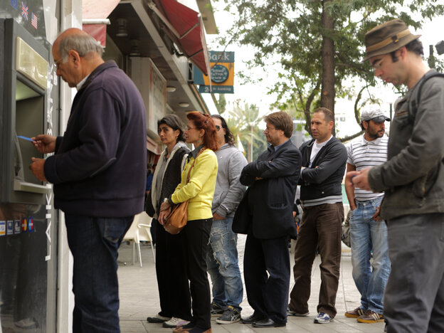 People line up at an ATM in Nicosia to withdraw cash on Thursday.