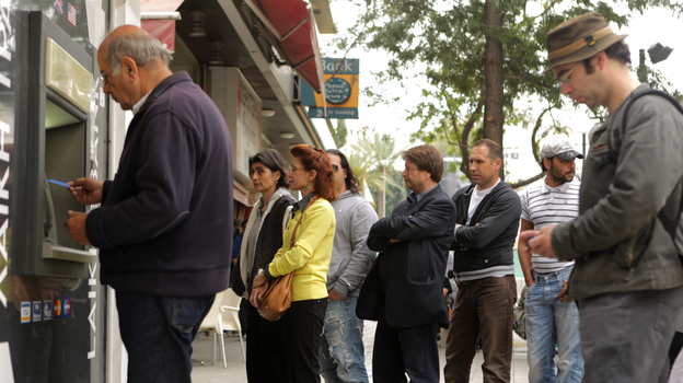 People line up at an ATM in Nicosia to withdraw cash on Thursday. (AFP/Getty Images)