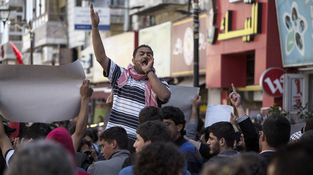 Palestinians protest as U.S. President Barack Obama and Palestinians Authority President Mahmud Abbas meet in Ramallah on Thursday. (Getty Images)
