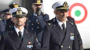 A December 22, 2012, photograph of Italian marines Massimiliano Latorre (R) and Salvatore Girone (L) at Ciampino airport near Rome.