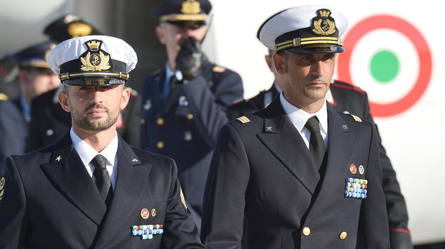A December 22, 2012, photograph of Italian marines Massimiliano Latorre (R) and Salvatore Girone (L) at Ciampino airport near Rome.