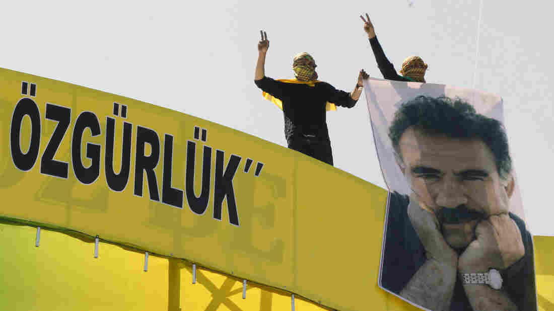 """Masked demonstrators show support for jailed Kurdish rebel leader Abdullah Ocalan, in the southeastern Turkish city of Diyarbakir on Thursday. Ocalan called for a """"new era"""" and a cease-fire in a battle against Turkey that's nearly three decades old."""