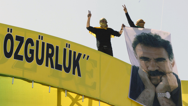 """Masked demonstrators show support for jailed Kurdish rebel leader Abdullah Ocalan, in the southeastern Turkish city of Diyarbakir on Thursday. Ocalan called for a """"new era"""" and a cease-fire in a battle against Turkey that's nearly three decades old. (AP)"""